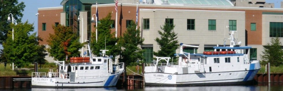 Two boats docked near Annis Water Resources Institute